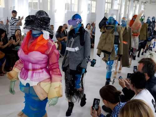 A French fashion house just sent models down the runway in colorful VR headsets and iPhone holsters for your ankle
