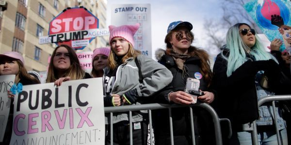 The National Archives blurred out signs criticizing Trump in an exhibited photo of the Women's March