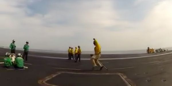 Hilarious video shows Navy officers having way too much fun launching aircraft