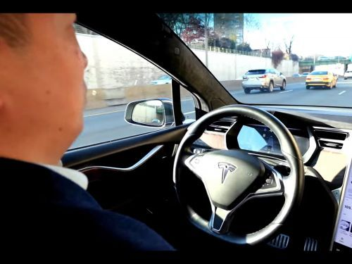 Andrew Yang uses Tesla's Autopilot feature in a new ad - and he breaks the same rule Elon Musk has on TV