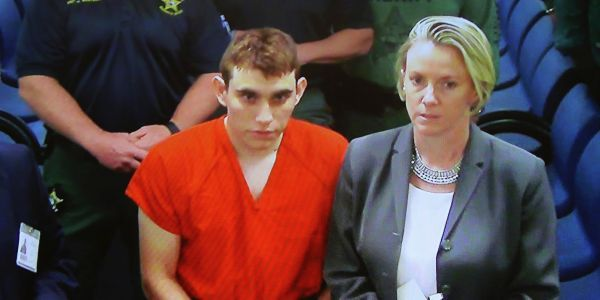 The Florida shooting suspect's mother reportedly told police he had been cutting himself and 'threatening her'