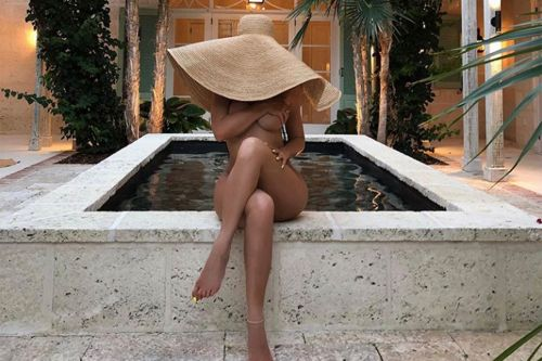 Big floppy hats are the new peek-a-boob trend on Instagram