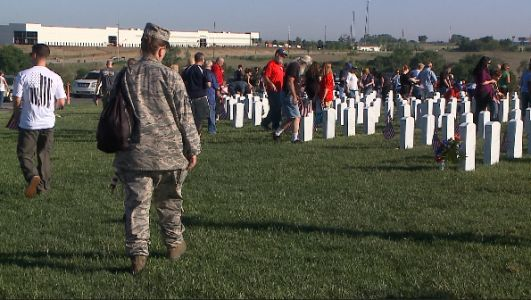 Families and Volunteers mark 1,000 veteran graves with flags for Memorial Day weekend
