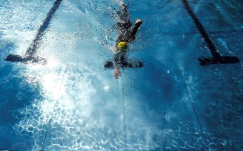 It's pretty safe to swim in a pool during the coronavirus pandemic. Just avoid the locker room and keep moving
