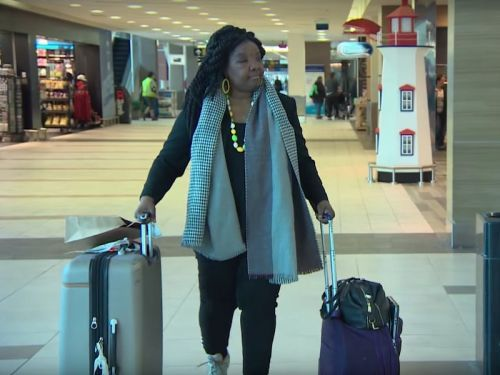 A black woman says she was removed from a plane because flight attendants believed she had a contagious disease - and she's accusing the airline of racism