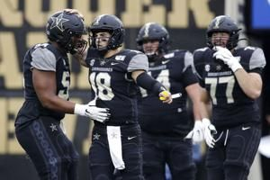 Vaughn scores twice, Vandy upsets No. 22 Missouri 21-14