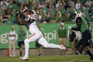 Finley leads NC State over Marshall 37-20