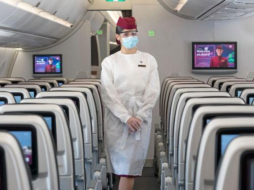 Qatar Airways is now requiring all passengers wear a face shield in addition to masks - except in business class