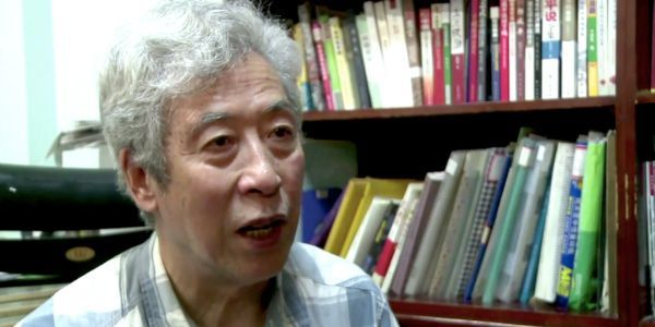 A Chinese professor was ominously forced off-air after police broke into his home during an interview criticizing the government