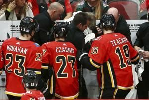 Coach hit by puck, Flames rout Coyotes 6-1
