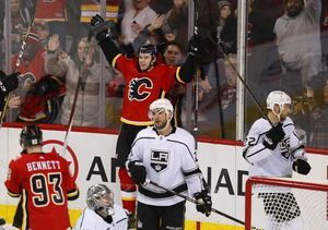 Flames use big 2nd period to rally past Kings for 4-3 win