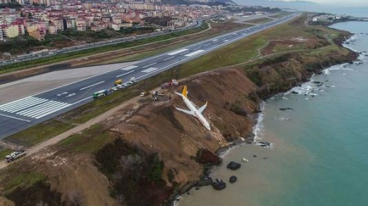WATCH: Plane veers off runway after landing and drapes off side of cliff