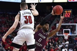 No. 1 Louisville breezes past EKU; No. 2 Kansas also wins