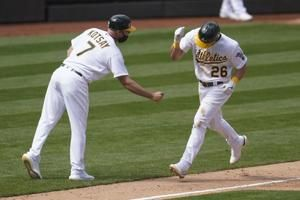 A's rally to beat Dodgers 4-3 in 10 for 1st win of season