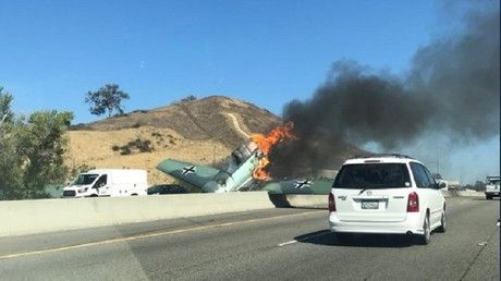WWII plane crashes on California freeway, pilot unharmed