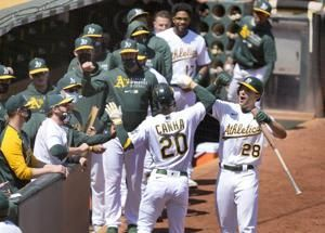 A's slug, pitch past Tigers 7-0 for 7th straight win