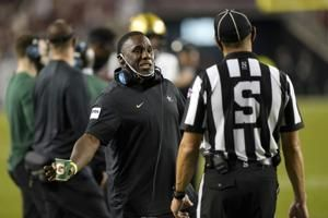 The Latest: Notre Dame COVID-19 outbreak affects 39 players