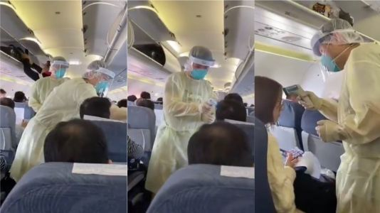 A video of medics in Hazmat suits scanning plane passengers for China's mysterious Wuhan virus is stoking fears of a global epidemic
