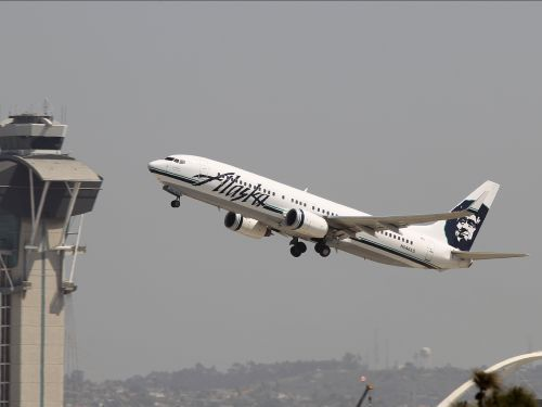 An Alaska Airlines passenger stripped naked and ran around the cabin before being detained