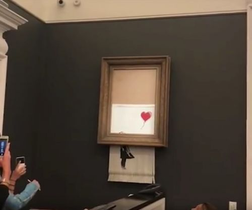 The woman who bought the shredded Banksy artwork is keeping it