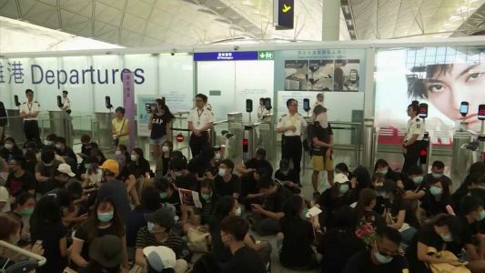 'Panic and chaos': Hong Kong suspends all airport check-ins, leader says city staring 'into the abyss'