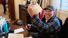 Insurrectionist Photographed In Nancy Pelosi's Office Says It's Unfair He Remains Jailed