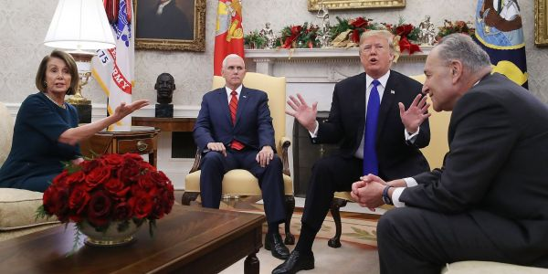 Trump gets into raucous, on-camera Oval Office debate with Schumer and Pelosi and says he'd be 'proud' to shut down the government