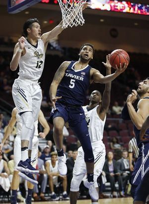 Bluiett scores 20 points, leads No. 15 Xavier past GW