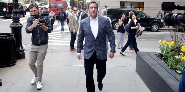 Pictures show Michael Cohen hanging out with friends, smoking cigars while his lawyers fought for him in court after FBI raid