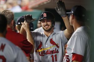 Cards power Weaver with 3 homers in 9-2 win over Reds