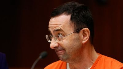 Disgraced former US Gymnastics doctor pleads guilty to child porn charges