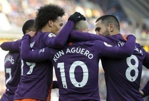City beats Huddersfield 3-0, moves 4 points behind Liverpool
