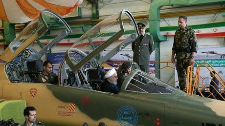 Iran unveils first domestic fighter jet, President Rouhani checks out the cockpit