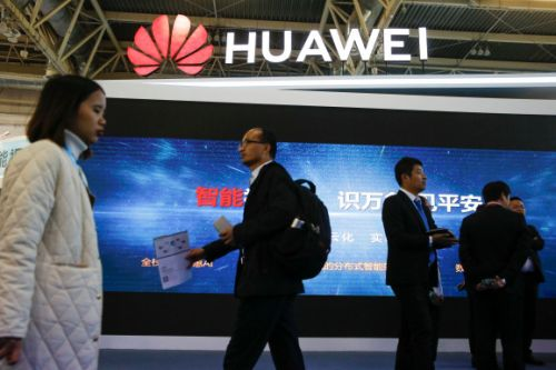 Facing bans, Huawei promises greater security and touts growing sales