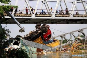 Indonesia bridge collapse kills 9, 1 missing