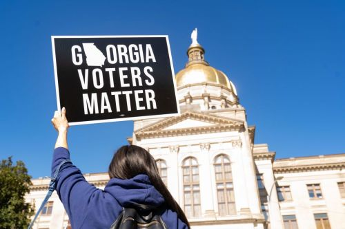 Voter Suppression Bills In Georgia: Companies Donating To Republicans' 'Big Lie' Stay Silent