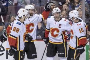 Giordano leads Flames past Canucks 3-1