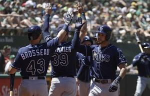 Rays come out swinging to beat A's 8-2, end long str