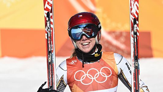 Czech snowboarder Ester Ledecka uses secondhand skis to win gold in her second-best sport