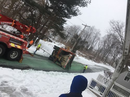 Plow truck flips onto side, others catch fire