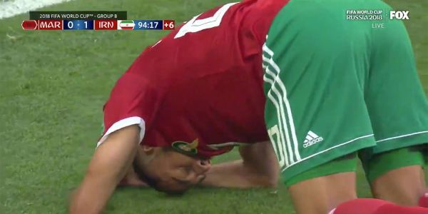Moroccan player heads the ball into his own net in stoppage time to give his team a heartbreaking loss to Iran