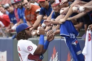 Guerrero Jr. makes Triple-A debut after stop in Cooperstown