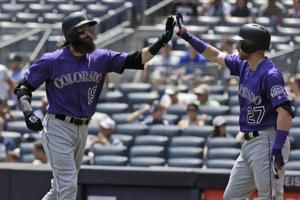 Paxton stumbles again, Rockies beat Yanks 8-4 to stop slide