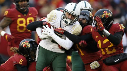 Watch: Baylor player reaches over referee to punch Iowa State RB