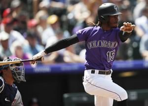 Tapia's 3-run double sparks Rockies over Nats, 9-5