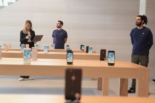 Apple is offering store workers $100 toward work-from-home gear and a new stress-management tool as other retailers cut costs and layoff employees