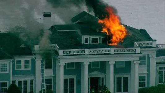 Firefighters face difficulty battling flames in 123-year-old mansion