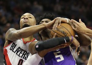 Kings bounce back from 46-point loss to beat Blazers 86-82