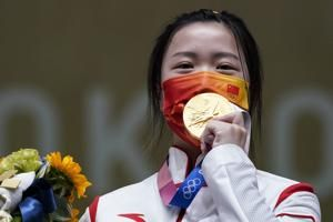 China's Yang takes first gold at uneasy Tokyo Olympics