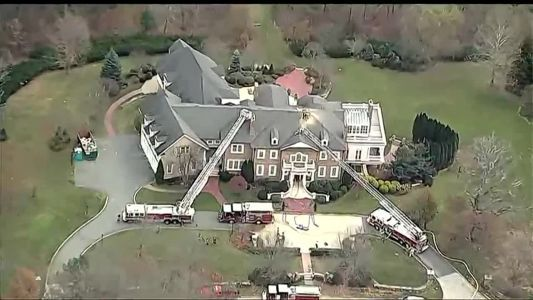 Firefighters battle balze at multi-million dollar home